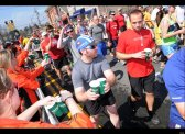 Runners stopping for water during the 2012 Boston Marathon.  Photo: hunffingtonpost.com